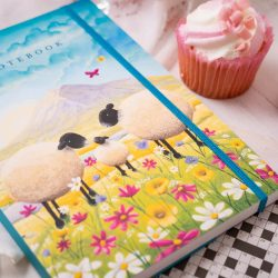 Notebook with sheep, butterflies and pink and yellow flowers
